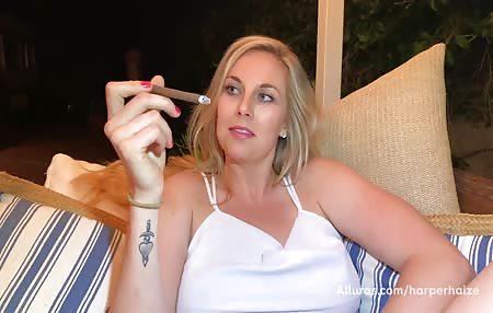 Just a sexy girl enjoying a smoke outside