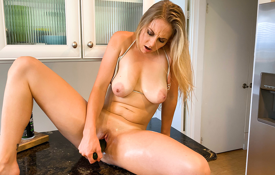 Getting naughty in the kitchen with a cucumber